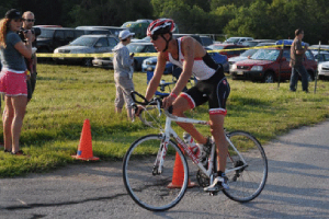 As he approaches the transition area of the Omaha, Neb., triathlon this past July, Eckardt prepares to dismount his bike and throw on his running shoes.