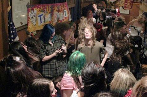Fans flooded the stage for Ted Bunny's last song and with all the bumping and head banging of long haired teens, they kept it together and rocked out with the fans until the end.