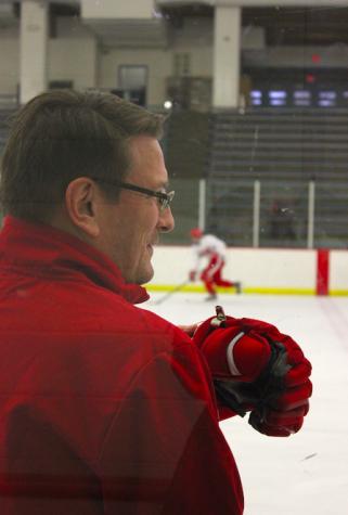 Head boys' hockey coach of twenty years Ken Pauly presides over practice.