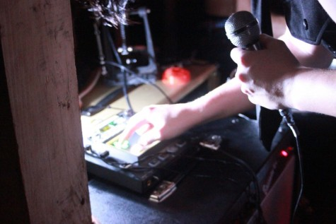 Avery Davis (11) plays a synth and vocoder solo on his Kaossilator.